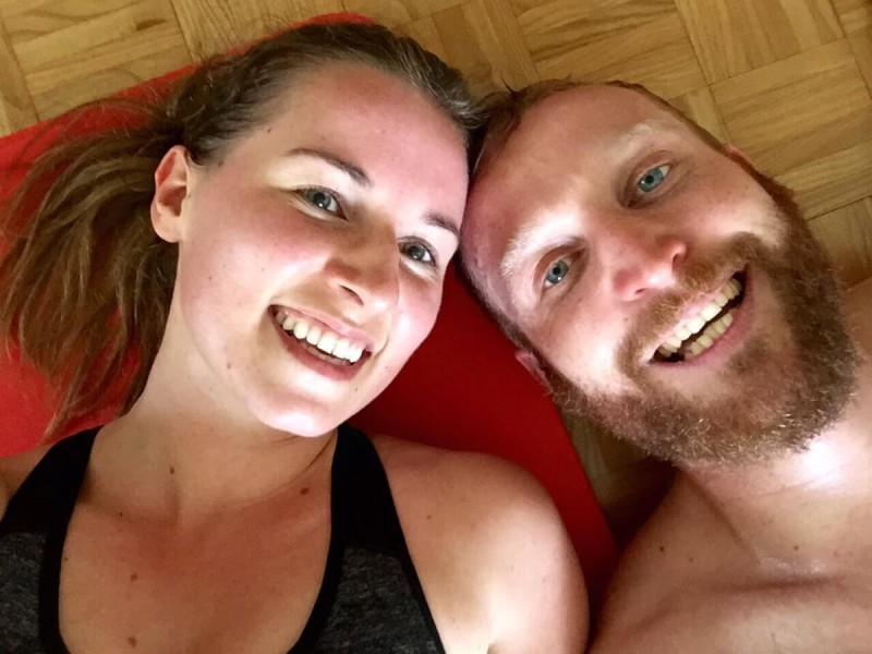 young couple after their workout on the mat