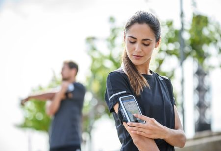 Woman using a mobile app to work out