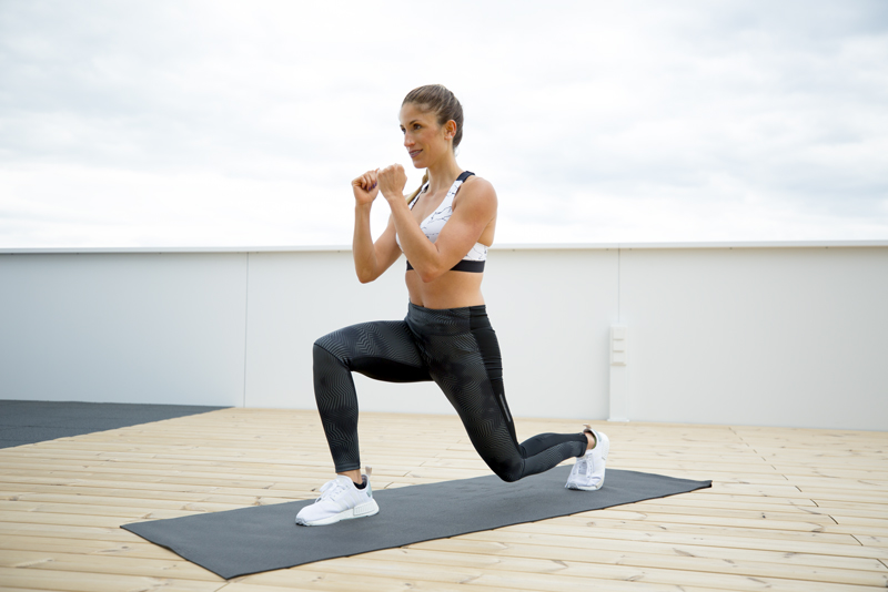 Woman is doing a lunge high knee and jump