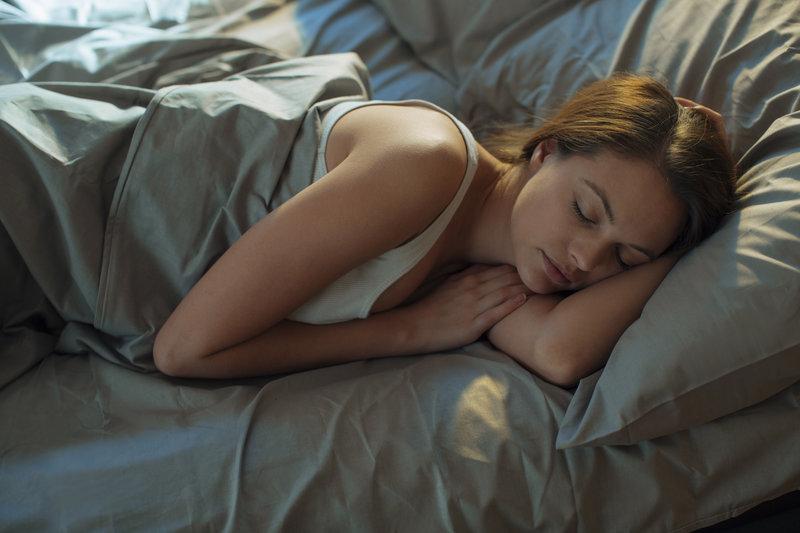 A woman is sleeping