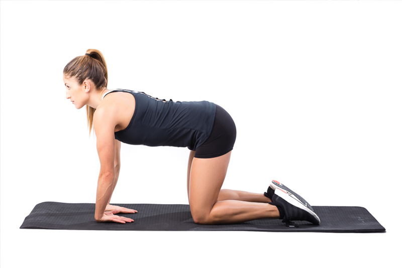 A woman doing bodyweight exercises