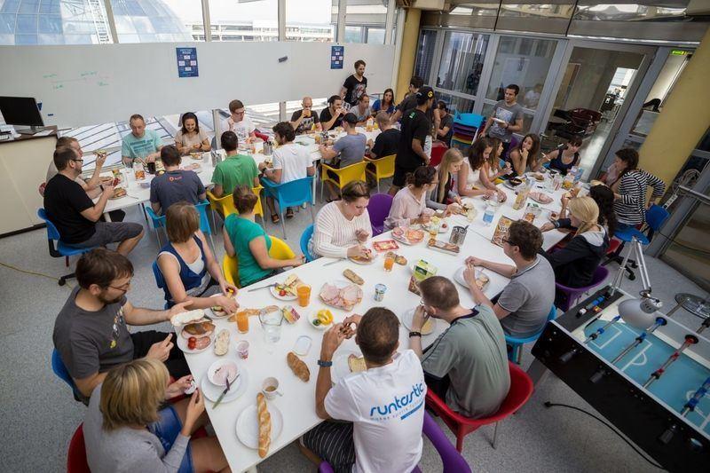 group of people having breakfast at Runtastic