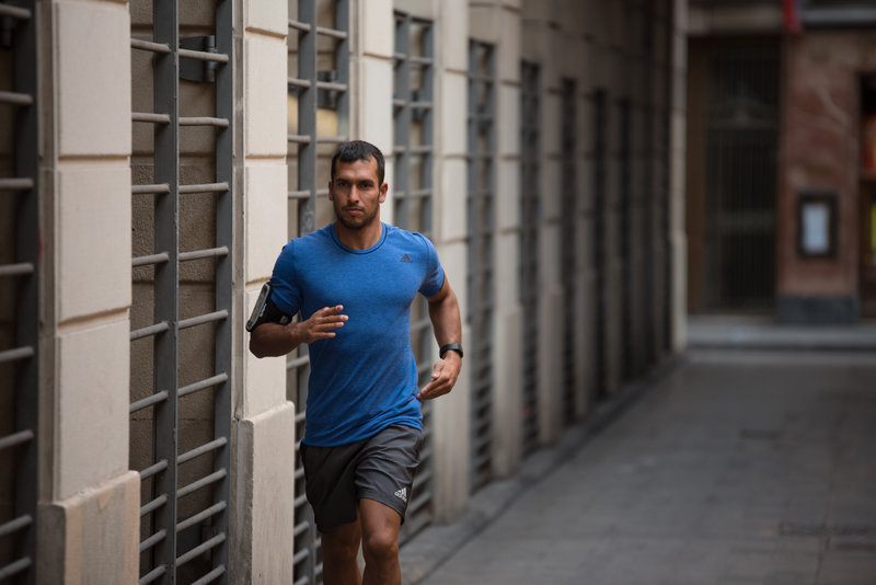 Young man running in the town.