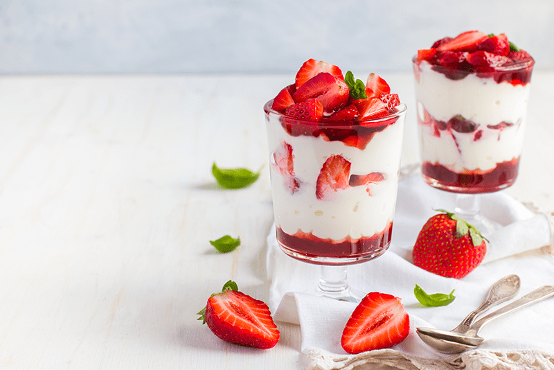 Two glasses of strawberry coconut parfait