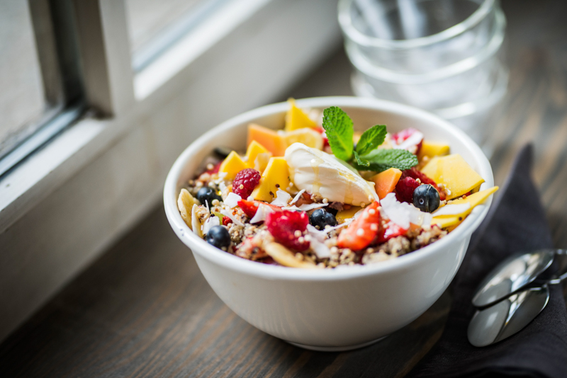 A bowl of cereal with lots of fruits