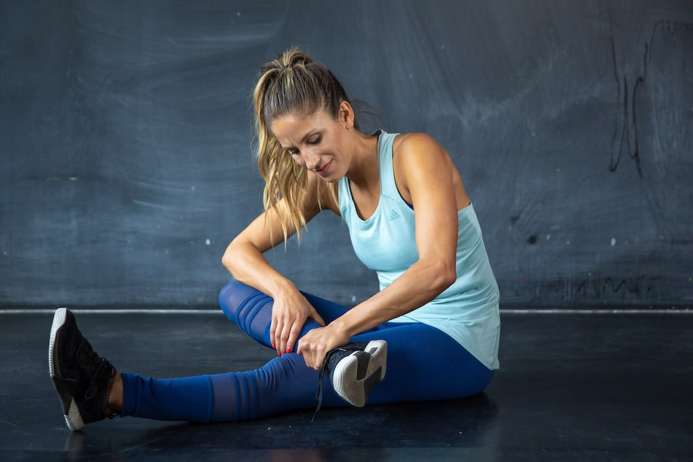 Woman with a muscle cramp