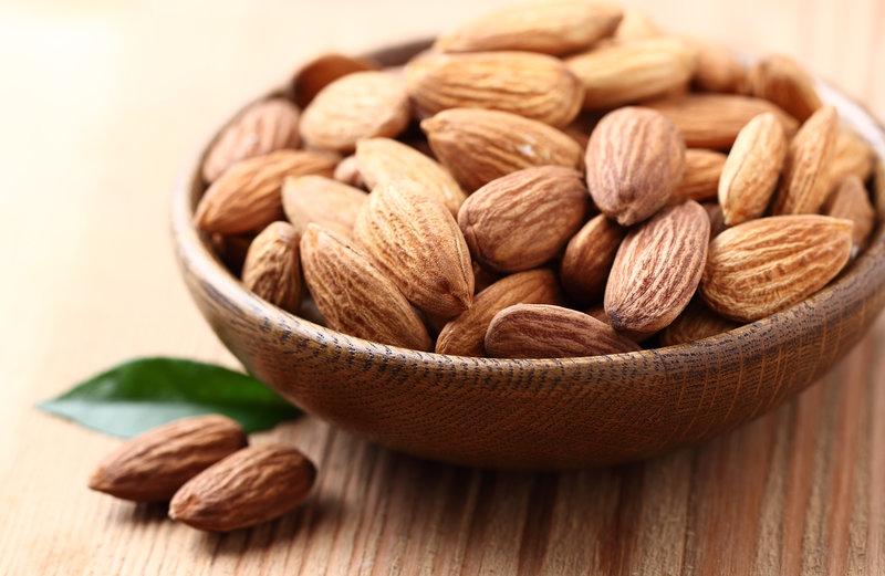 Almonds in wooden vessel