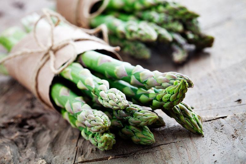 Raw asparagus on a wooden table