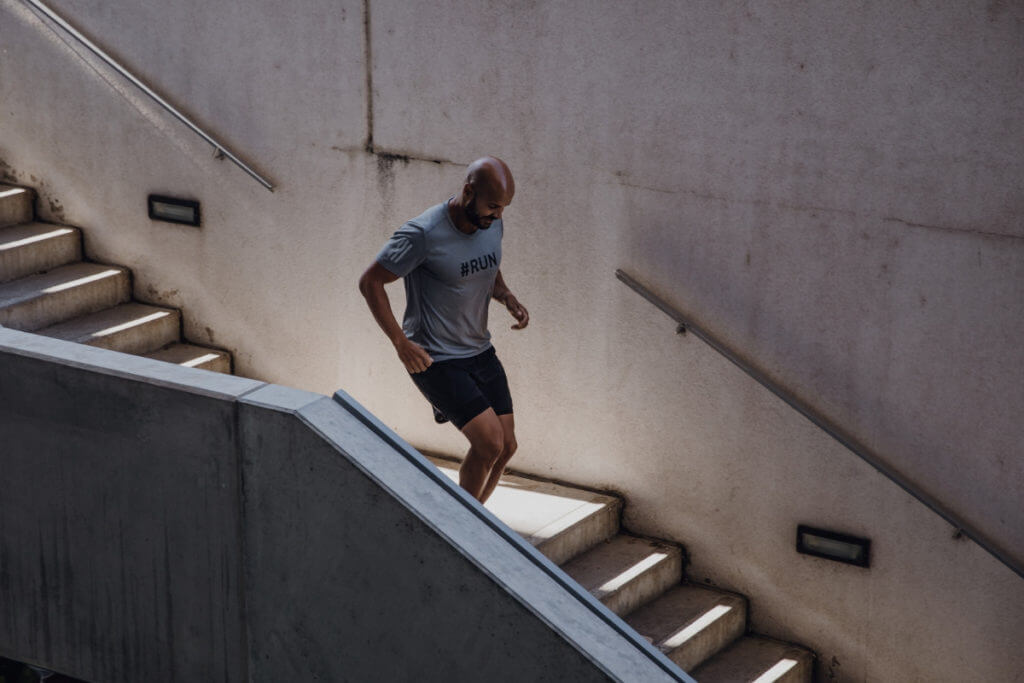 man running downstairs