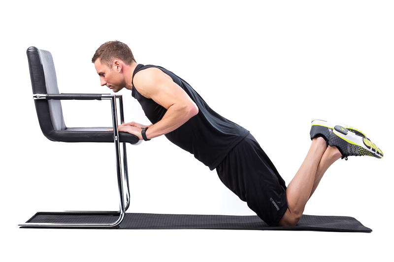 Man doing incline knee-push-up