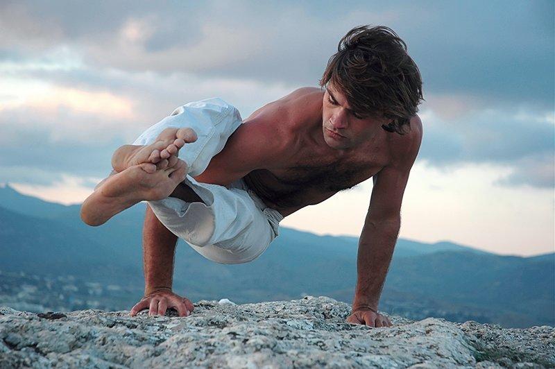 young man doing a yoga pose