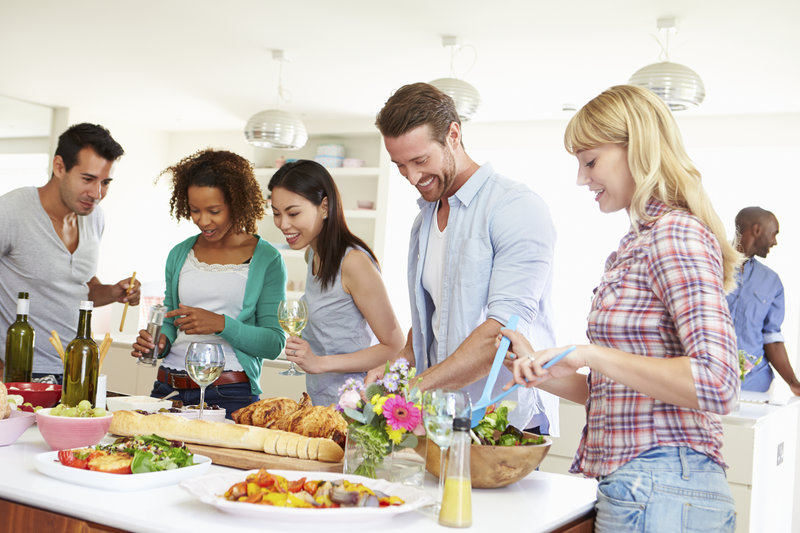 Group of friends is preparing food together.