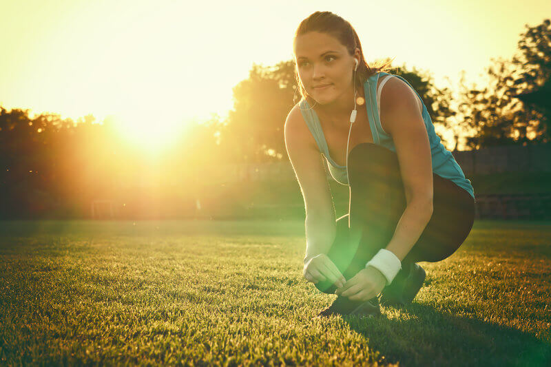 Girl prepares herself for a running session.