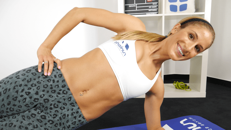 Woman doing a side plank.