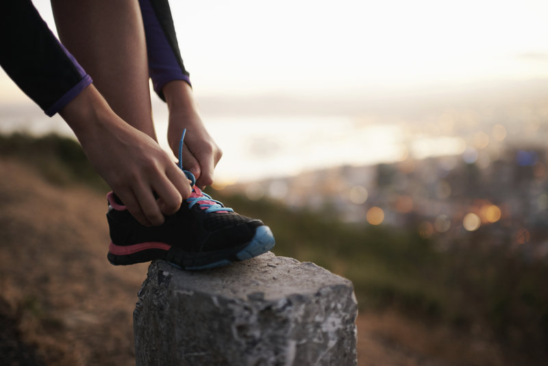 Cropped shot of a young athlete doing her shoelaces