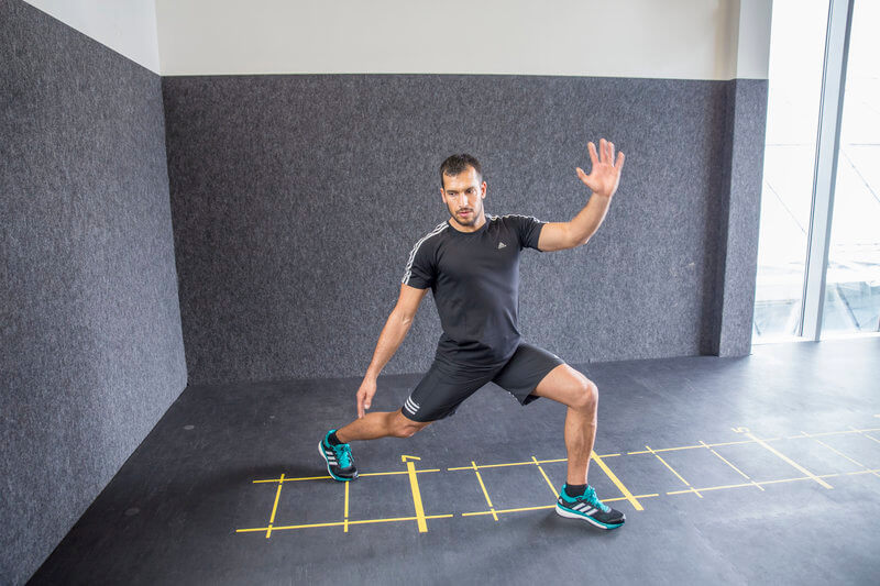 Young man who is doing a Backward Lunge.