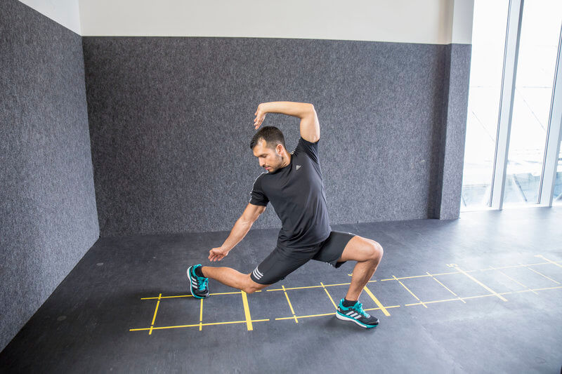Young man is doing a Backward lunge.