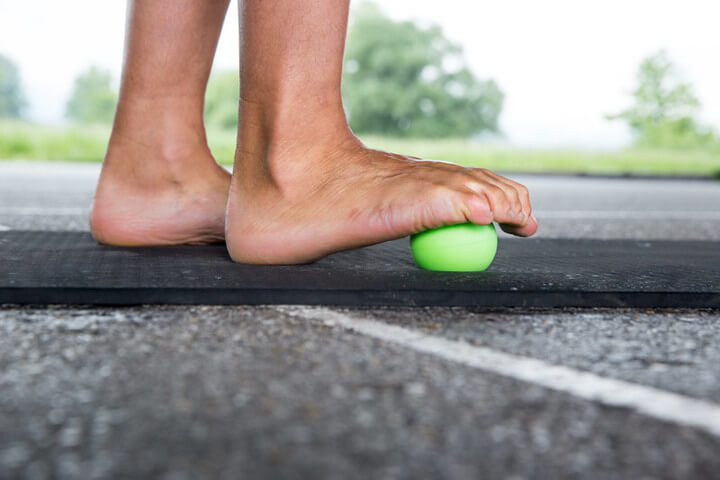 A man is ending the foot rolling.