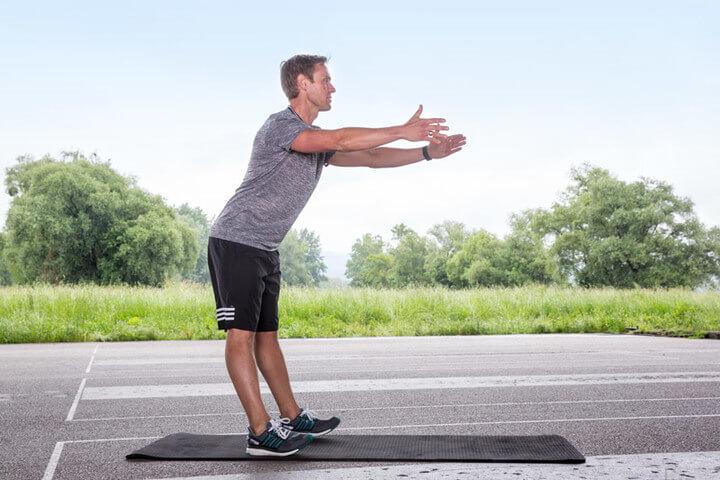 Man starts doing the heel-to-toe raise.