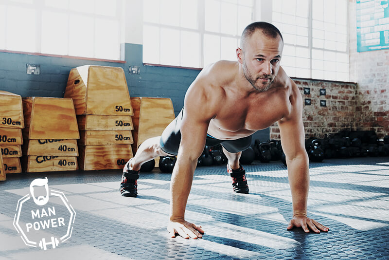 Athletic man doing a Push-up.