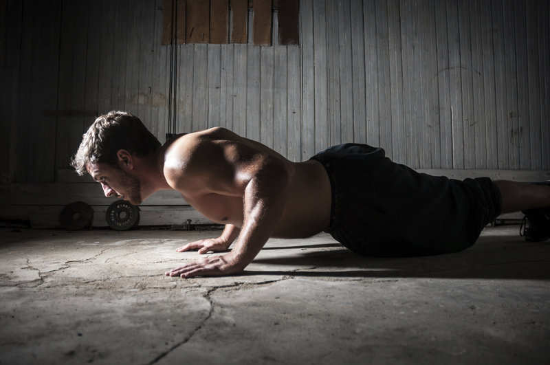 Athletic man doing push-ups.