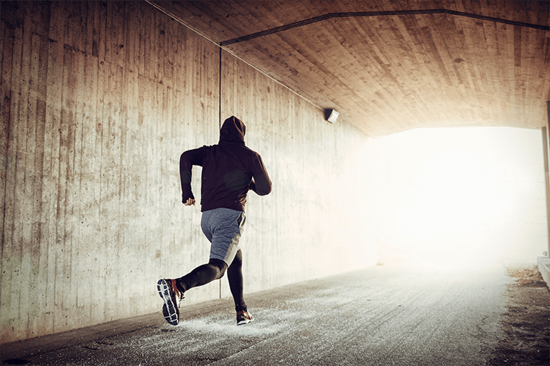 Man running in a tunnel.