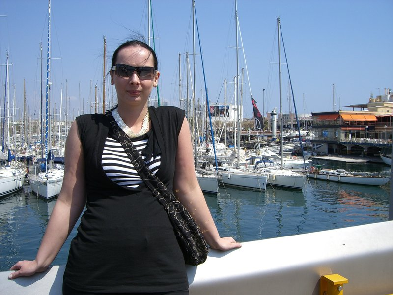 Young woman at the harbour in summer.