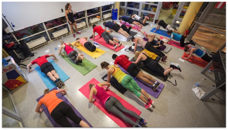 Group of Runtastics doing a workout together in the office.