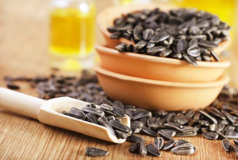 Sunflower seeds on a wooden table.