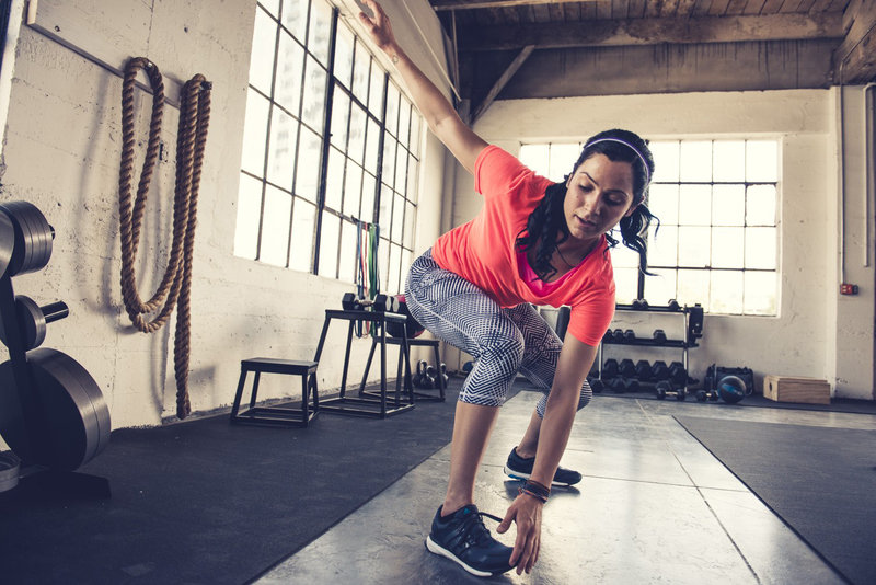 Woman is stretching before her workout