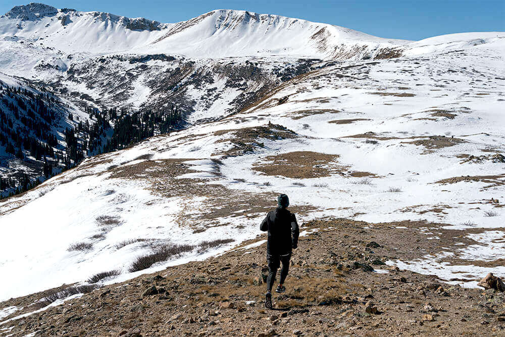 A trail runner on his way up to a mountain
