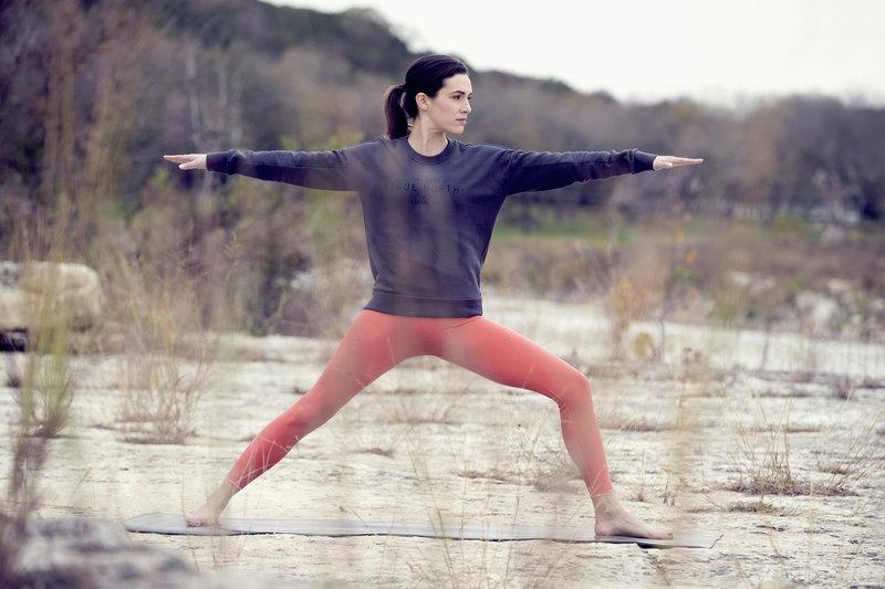 Adriene Mishler doing Yoga