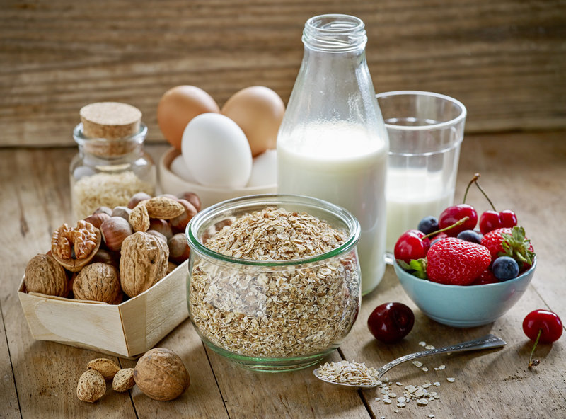 healthy breakfast ingredients on old wooden table