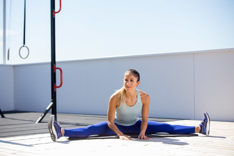 Woman is doing an adductor stretch