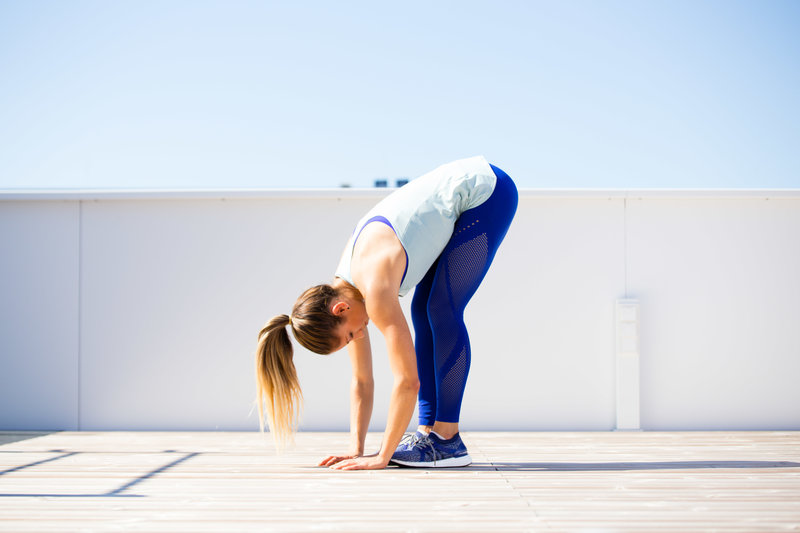 Woman is doing an erector spinae stretch