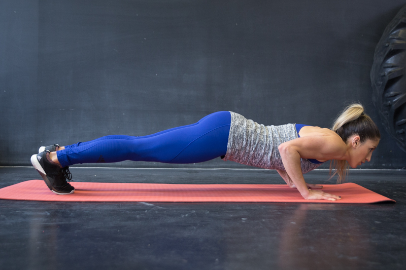 A woman is doing narrow push-ups