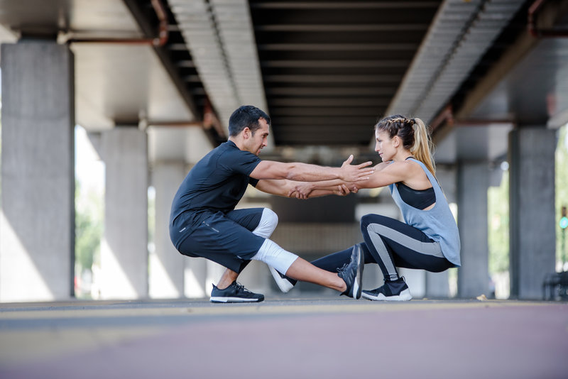 A man and a woman doing a partner workout
