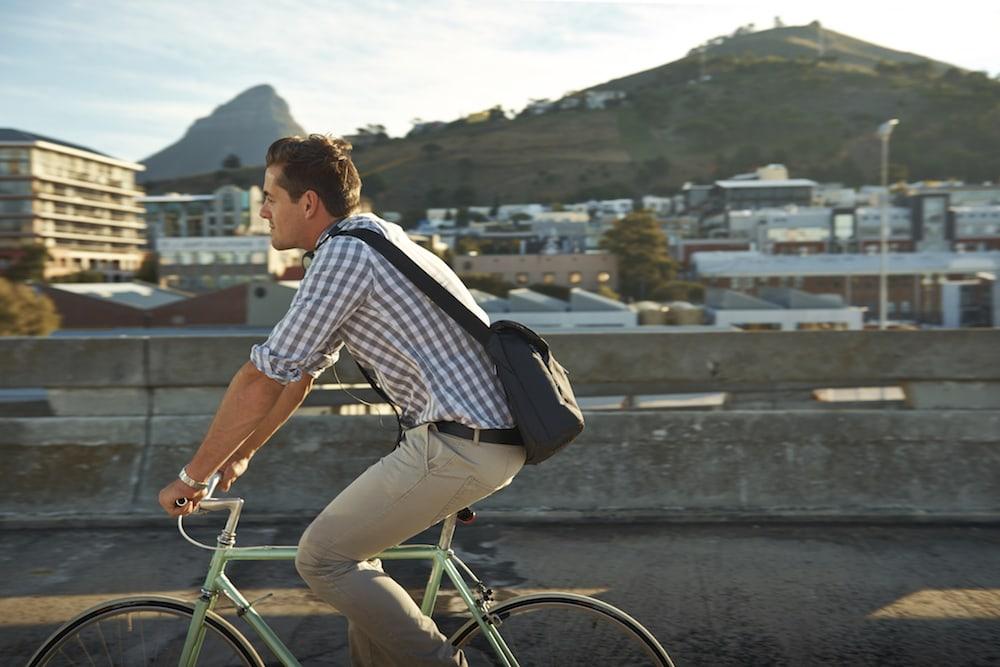 Man on a bike without a helmet