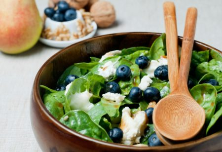 Blueberries and leaf greens in a bowl