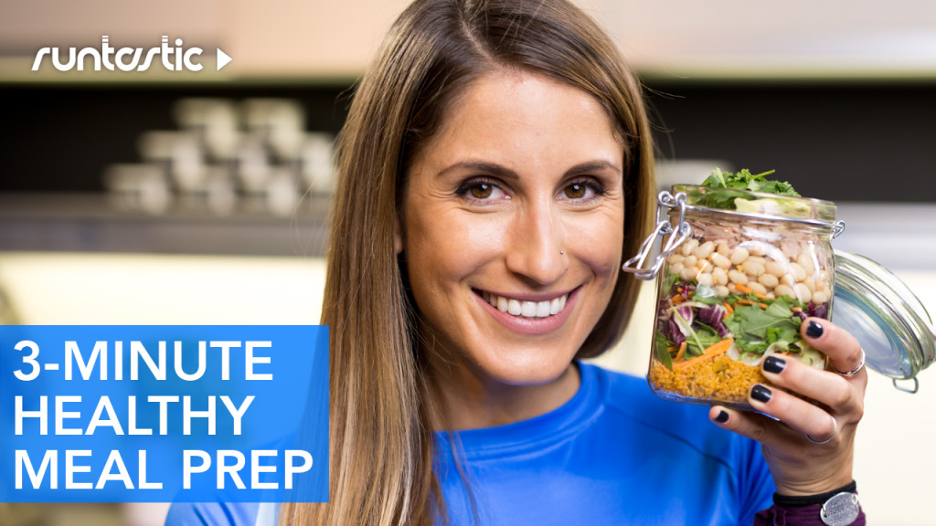attractive woman holding a healthy meal in a mason jar