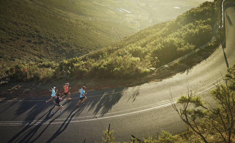 Aerial shot of a group of runners on a country road
