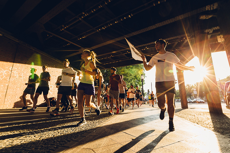 A group of people running a marathon together