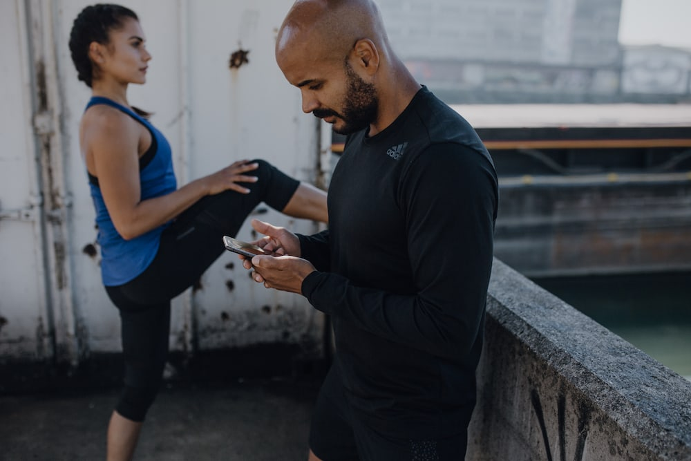 Man reading a fitness post