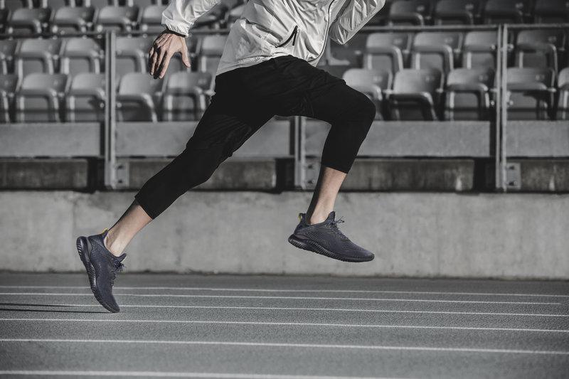 Close up image of an man running.