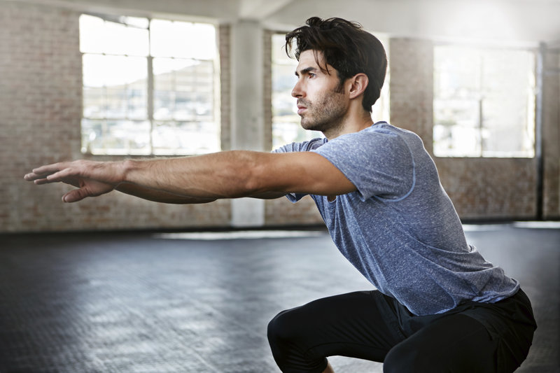A man who is doing a workout without fitness-equipment.