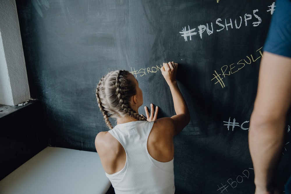 Woman writing on a chalk board