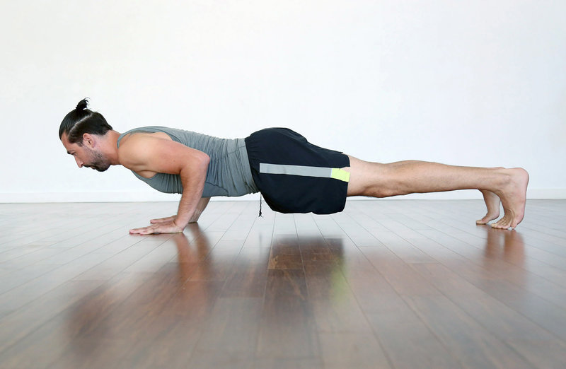 Young man doing a push-up