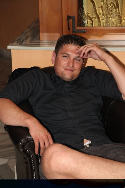 Young overweighted man sitting on a chair.
