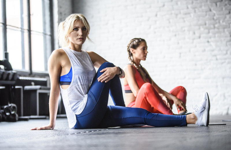 Two athletic girls doing Runtastic Results for women.