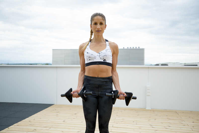 Woman is doing a bicep curl